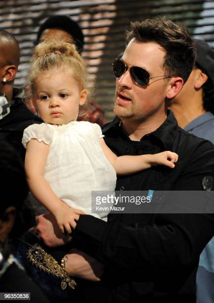HOLLYWOOD FEBRUARY 01 Singer Joel Madden and daugher Harlow Madden perform at the We Are The World 25 Years for Haiti recording session held at Jim...