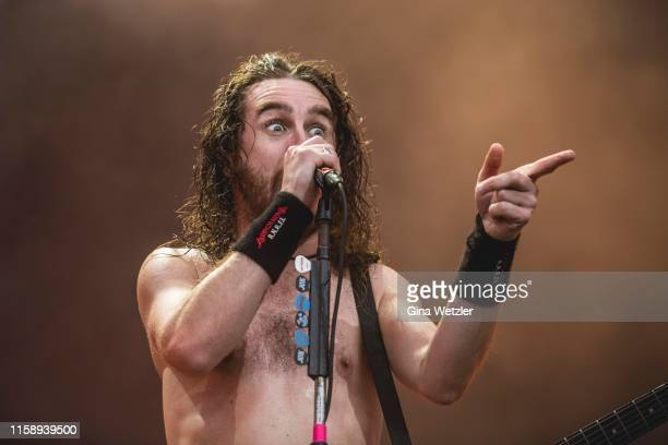 Singer Joel OKeeffe of the Australian band Airbourne performs live on stage during the first day of the Wacken Open Air festival on August 1 2019 in...