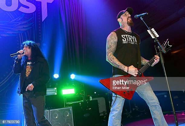 Singer Joey Belladonna of Anthrax joins guitarist John Connolly of Sevendust onstage as they perform the song 'Face to Face' during a stop of...