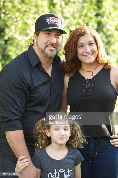 Singer Joey Fatone daughter Kloey Alexandra Fatone and wife Kelly Baldwin attend the World Premiere of Disney's Pete's Dragon at the El Capitan...