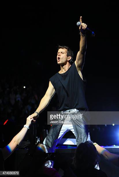 Singer Joey McIntyre of NKOTB performs at Sprint Center on May 19 2015 in Kansas City Missouri