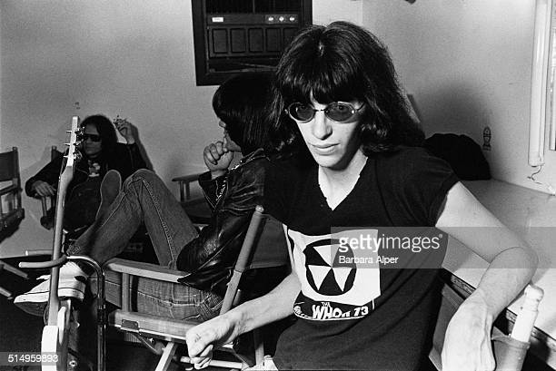 Singer Joey Ramone of American punk group The Ramones backstage at the Paradise Theater in Boston Massachusetts 22nd March 1978 In the background are...
