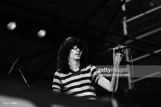 Singer Joey Ramone of the rock group The Ramones performs at the Schaefer Music Festival on August 11 1980 in Central Park New York City New York