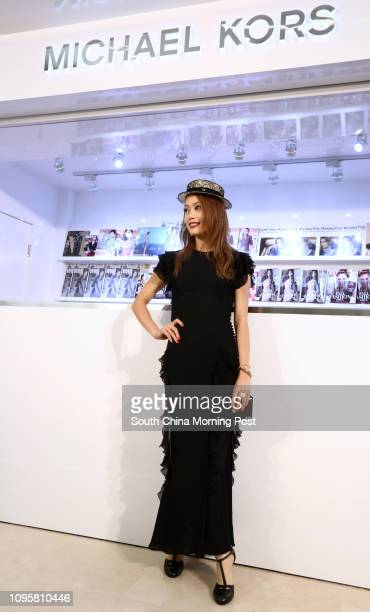 Singer Joey Yung Choyee poses for pictures at the grand opening of the Michael Kors store at Fashion Walk in Causeway Bay 02AUG15