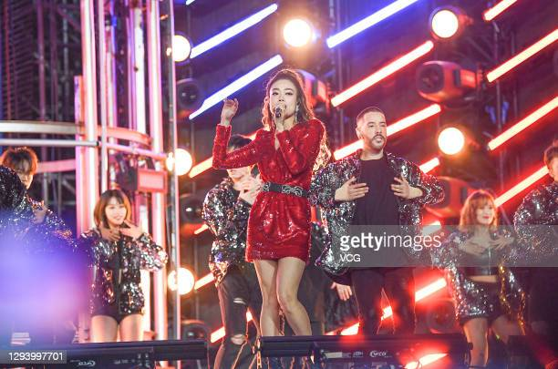 Singer Joey Yung performs on the stage during Hunan Television New Year Gala on December 31, 2020 in Haikou, Hainan Province of China.