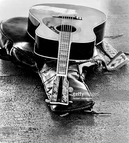 Singer John Denver's guitar lies on a stage at the Kennedy Space Center in Florida following the launch of the Space Shuttle Challenger carrying the...