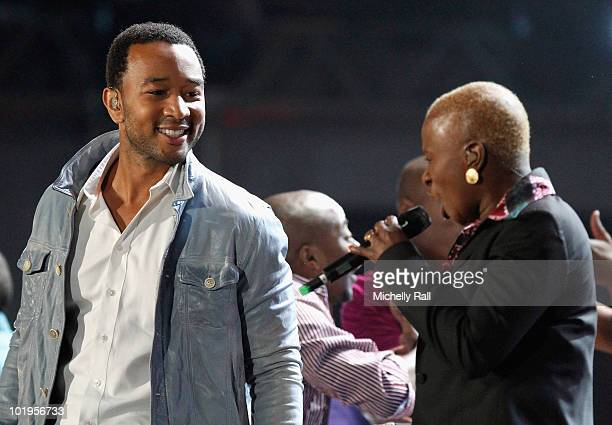 Singer John Legend and Benin singer Angelique Kidjo perform on stage during the FIFA World Cup Kickoff Celebration Concert at the Orlando Stadium on...