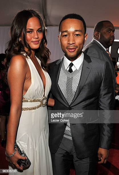 Singer John Legend and guest arrive at the 52nd Annual GRAMMY Awards held at Staples Center on January 31, 2010 in Los Angeles, California.