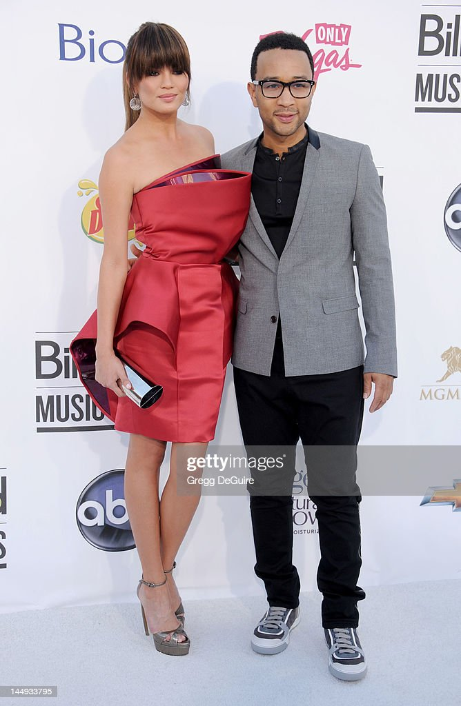 Singer John Legend (R) and model Chrissy Teigen arrive at the 2012 Billboard Music Awards at MGM Grand on May 20, 2012 in Las Vegas, Nevada.