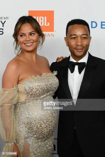 Singer John Legend and Model Chrissy Teigen arrive for the traditionnal Clive Davis party on the eve of the 60th Annual Grammy Awards on January 28...