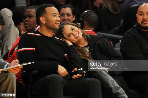 Singer John Legend and wife model Chrissy Teigen attend a basketball game between the Los Angeles Lakers and the Denver Nuggets at Staples Center on...