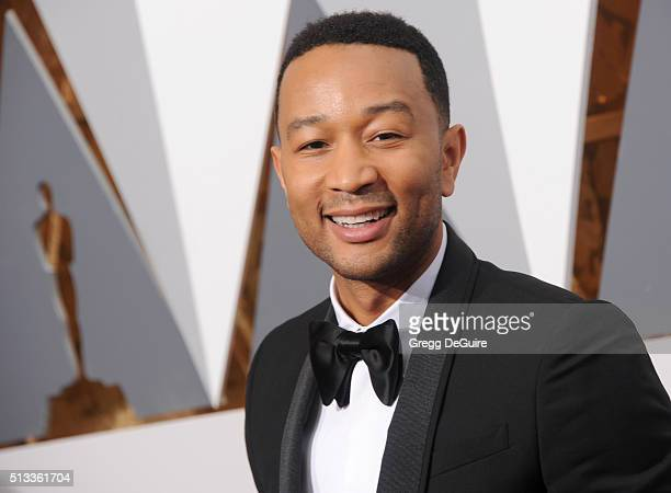 Singer John Legend arrives at the 88th Annual Academy Awards at Hollywood Highland Center on February 28 2016 in Hollywood California