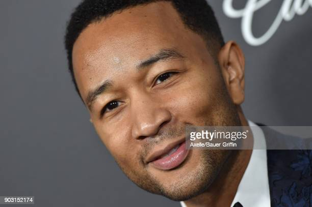 Singer John Legend arrives at The Art of Elysium's 11th Annual Celebration Heaven at Barker Hangar on January 6 2018 in Santa Monica California