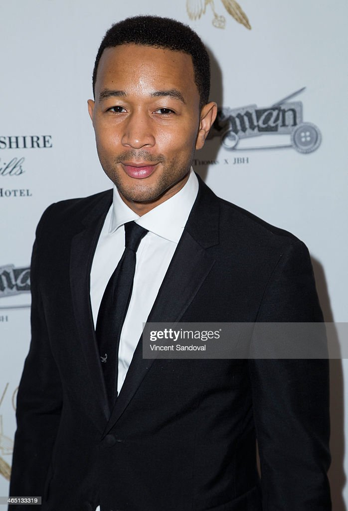Singer John Legend attends Jason Of Beverly Hills' Pre-GRAMMY cocktail hour and salute to fashion icon David Thomas' Gentleman Collection at The Blvd on January 25, 2014 in Los Angeles, California.