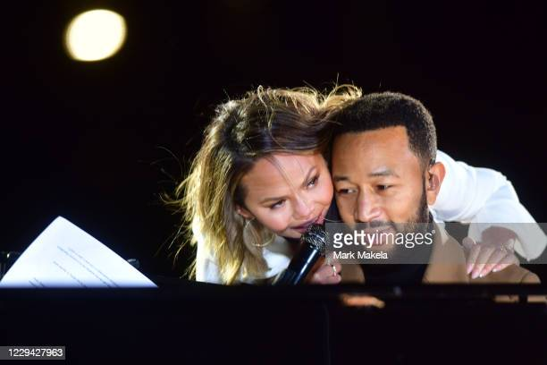 Singer John Legend is joined onstage by his wife, Chrissy Teigen, while performing before Democratic vice presidential nominee Sen. Kamala Harris...