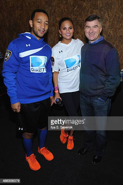Singer John Legend model Chrissy Teigen and DIRECTV Chairman President CEO Michael White attend the DirecTV Beach Bowl at Pier 40 on February 1 2014...