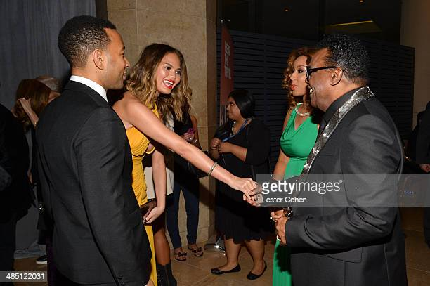 Singer John Legend, model Christine Teigen, Kandy Johnson Isley, and musician Ron Isley attend the 56th annual GRAMMY Awards Pre-GRAMMY Gala and...