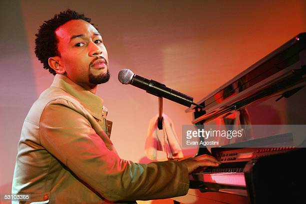 Singer John Legend performs at an exclusive concert and fan signing session as part of his partnership with Target to celebrate Black Music Month at...