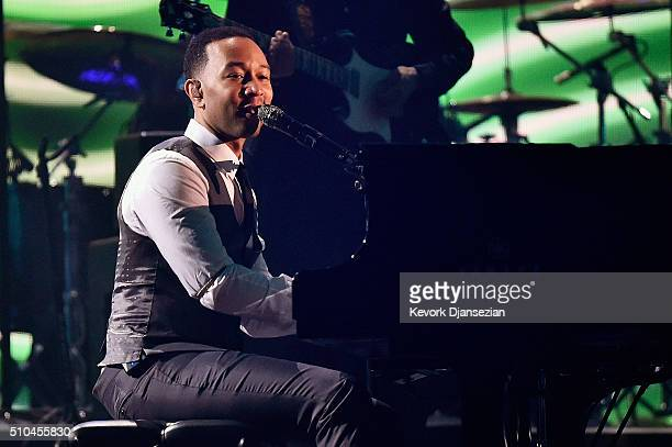 Singer John Legend performs onstage during The 58th GRAMMY Awards at Staples Center on February 15 2016 in Los Angeles California