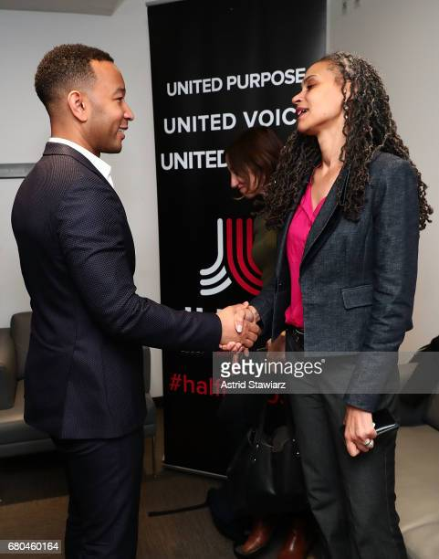 Singer John Legend poses for photos backstage with Senior Vice President for Social Justice at The New School Maya Wiley during Close Rikers Free...