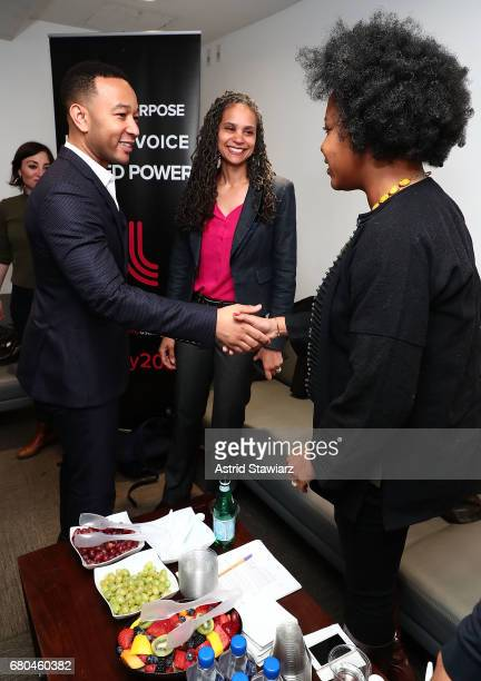 Singer John Legend poses for photos backstage with Senior Vice President for Social Justice at The New School Maya Wiley and Associate Professor of...