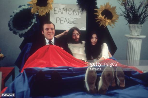Singer John Lennon and his wife Japanese born artist Yoko Ono in bed with Eamonn Andrews while appearing on the 'Today' programme 1st April 1969