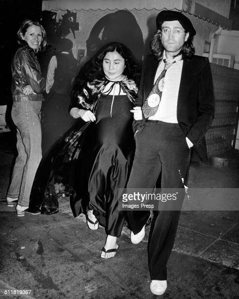 Singer John Lennon and pregnant wife Yoko Ono photographed leaving an upscale restaurant in New York City on September 9 1975