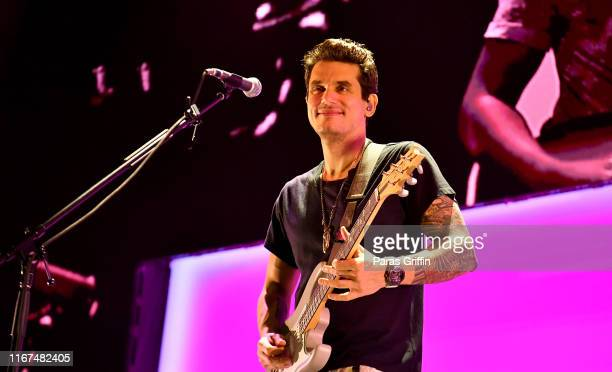 """Singer John Mayer performs onstage during his """"Evening With John Mayer"""" tour at State Farm Arena on August 11 2019 in Atlanta Georgia"""