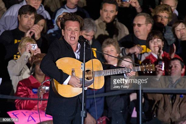 Singer John Mellencamp performs before Democratic presidential hopeful New York Senator Hillary Rodham Clinton at a campaign stop at White River...