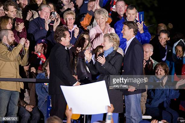 Singer John Mellencamp welcomes Democratic presidential hopeful New York Senator Hillary Rodham Clinton,and Indiana Governor Evan Bayh to the stage...