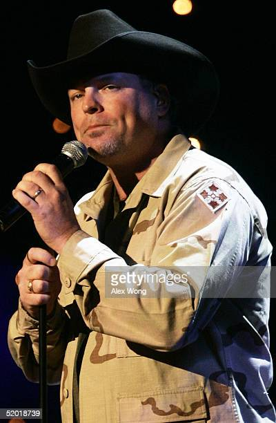 Singer John Michael Montgomery performs during the Saluting Those Who Serve event January 18 2005 at the MCI Center in Washington DC The event is...