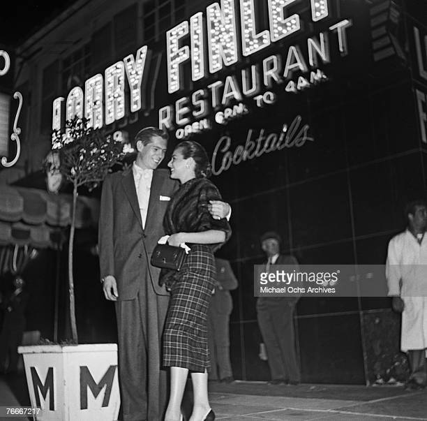 Singer Johnnie Ray comes out of the famous Mocambo nightclub on the Sunset Strip on June 7 in Hollywood, California. Note Larry Finley's restaurant...