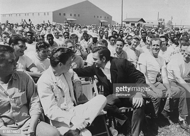 Singer Johnny Cash as he chats with some of the inmates and guests during his visit to Cummins Prison in Arkansas April 10 1969