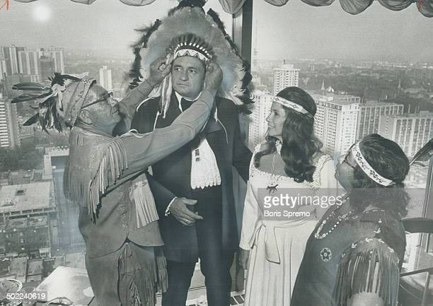 Singer Johnny Cash takes on a new name Da Gyn Da Geah-it means He is Coming with the Song - and an Iroquois headdress from Chief Joseph Logan; of the...