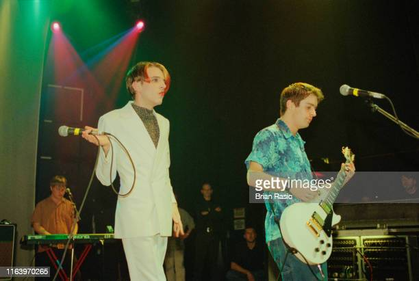 Singer Johnny Dean and guitarist Simon White of Britpop group Menswear perform live on stage at Shepherd's Bush Empire in London during the band's...