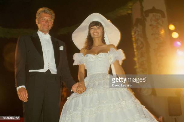Singer Johnny Hallyday and his bride Adeline on their wedding day in Ramatuelle