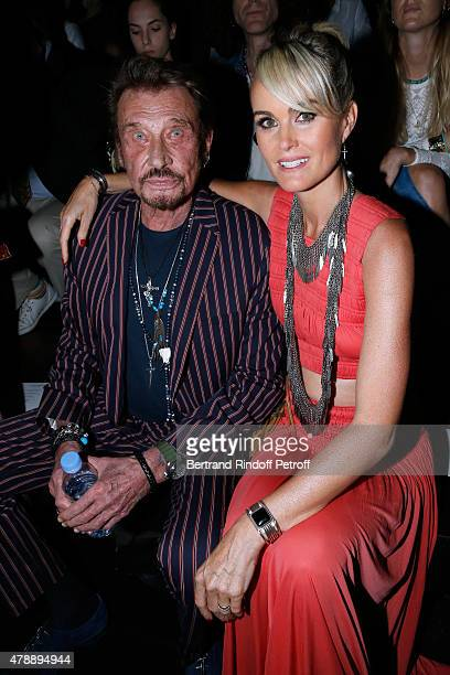 Singer Johnny Hallyday and his wife Laeticia attend the Saint Laurent Menswear Spring/Summer 2016 show as part of Paris Fashion Week on June 28 2015...