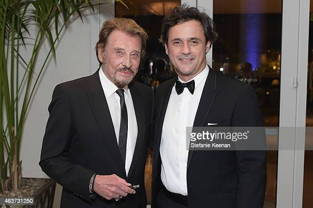 Singer Johnny Hallyday and President and Chief Executive Officer for Lacoste North America Francis Pierrel attend the 17th Costume Designers Guild...