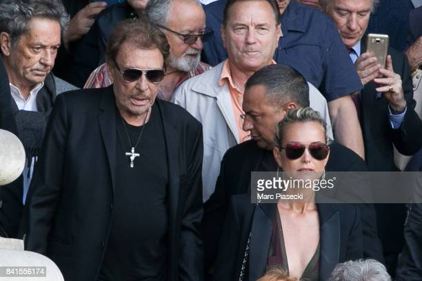 Singer Johnny Hallyday and wife Laeticia Hallyday attend actress Mireille Darc's Funerals at Eglise SaintSulpice on September 1 2017 in Paris France