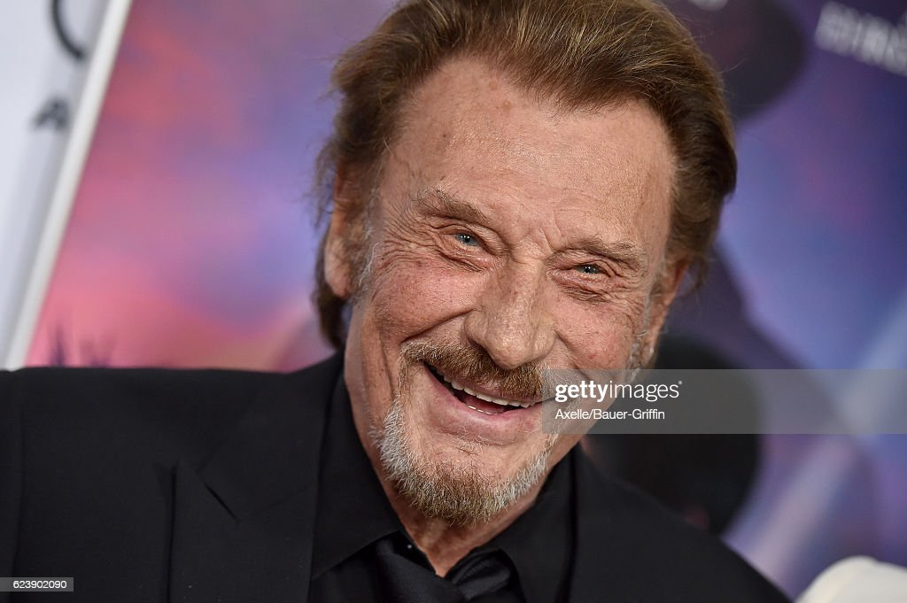 Singer Johnny Hallyday arrives at AFI FEST 2016 Presented by Audi - Opening Night - Premiere of 20th Century Fox's 'Rules Don't Apply' at TCL Chinese Theatre on November 10, 2016 in Hollywood, California.