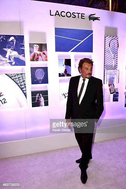Singer Johnny Hallyday attends the 17th Costume Designers Guild Awards with presenting sponsor Lacoste at The Beverly Hilton Hotel on February 17...