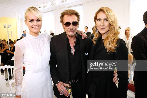 Singer Johnny Hallyday standing between his wife Laeticia and singer Celine Dion attend the Christian Dior Haute Couture Fall/Winter 20162017 show as...