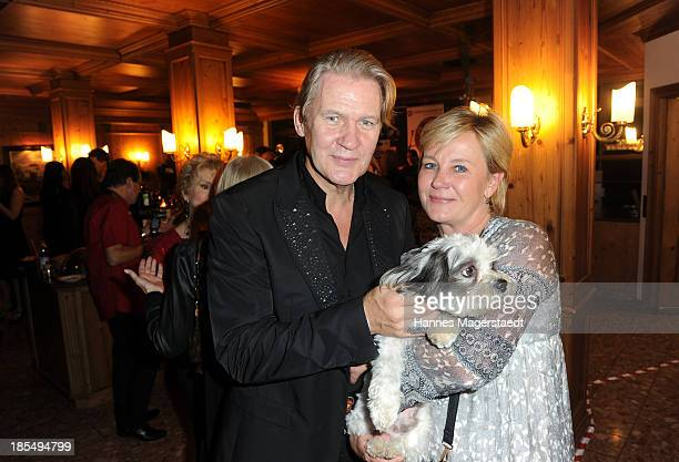 Singer Johnny Logan and his girlfriend Tanja Surmann with their dog Balu attend the presentation of Manfred Baumann New Calendar 2014 at the King's...
