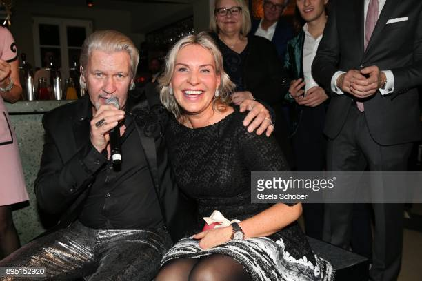 Singer Johnny Logan and Saskia Greipl during the annual Christmas Roast Kid Dinner on December 18 2017 in Munich Germany