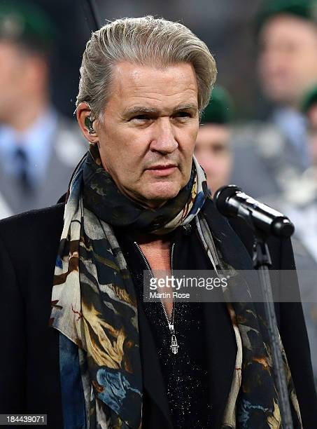 Singer Johnny Logan looks on the FIFA 2014 World Cup Qualifier group C match between Germany and Ireland at RheinEnergieStadion on October 11 2013 in...