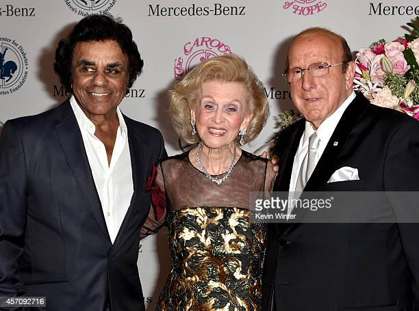 Singer Johnny Mathis Carousel of Hope Chairman Barbara Davis and Sony Music Entertainment Chief Creative Officer Clive Davis attend the 2014 Carousel...