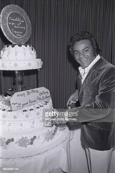 Singer Johnny Mathis Cuts His Birthday Cake After