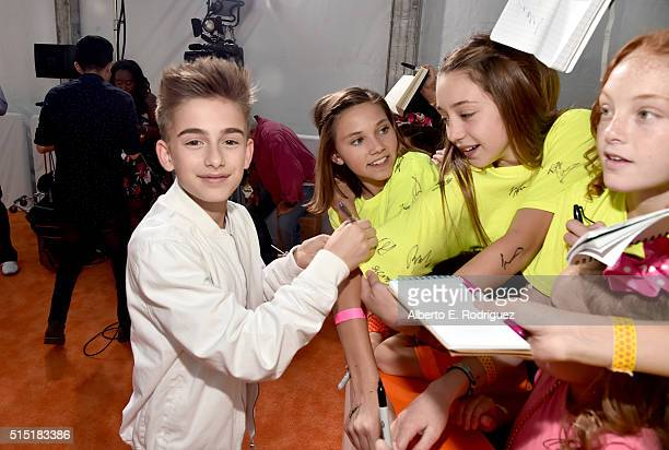 Singer Johnny Orlando signs autographs at Nickelodeon's 2016 Kids' Choice Awards at The Forum on March 12 2016 in Inglewood California