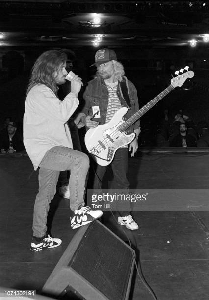 Singer Johnny Van Zant of the reunited Lynyrd Skynyrd relaxes with Lynyrd Skynyrd bassist Leon Wilkeson at rehearsal before the concert at the...