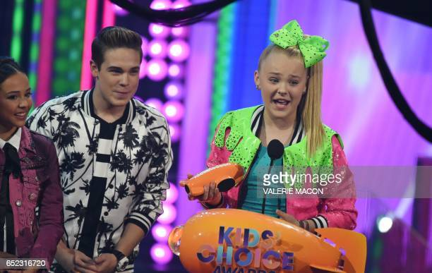 Singer JoJo Siwa accepts the award for Favorite Viral Music Artist on stage at the 30th Annual Nickelodeon Kids' Choice Awards March 11 at the Galen...